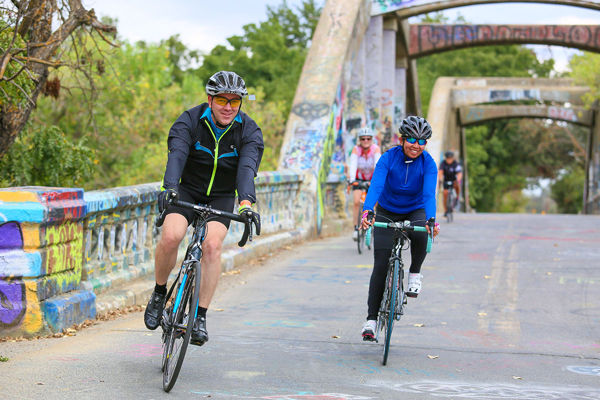 People cycling over a bridge
